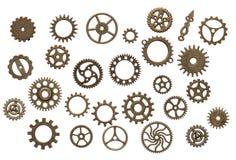 在白色背景隔绝的黄铜嵌齿轮轮子 免版税库存图片