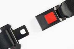 在白色背景隔绝的黑色开放安全带 免版税库存照片
