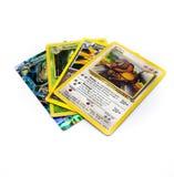 在白色背景隔绝的4张Pokemon卡片的汇集 库存照片