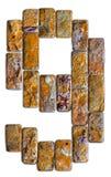 在白色背景隔绝的9自然石头的黄色数字 库存图片