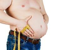 在白色背景隔绝的一个肥胖人的腹部 肥胖人hol 库存图片