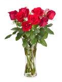 在白色背景隔绝的一个玻璃花瓶的玫瑰 图库摄影