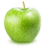 在白色背景隔绝的一个绿色苹果 库存照片