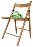 在白色背景隔绝的一把木椅子的绿色毯子 库存照片