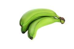 在白色背景隔绝的三个绿色香蕉 没有树荫 免版税库存照片