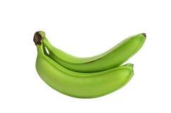 在白色背景隔绝的三个绿色香蕉 没有树荫 免版税图库摄影
