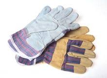 在白色背景隔绝的两个对防护工作手套 库存图片