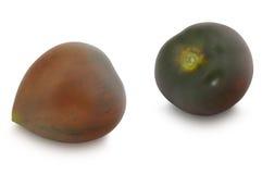 在白色背景隔绝的两个Kumato蕃茄 库存照片
