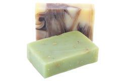 在白色背景隔绝的两块手工制造巧克力春黄菊肥皂 图库摄影