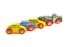 在白色背景隔绝的五辆老减速火箭的玩具汽车 库存照片