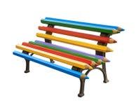 在白色背景隔绝的五颜六色的铅笔长凳  免版税库存图片