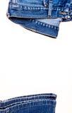 在白色背景隔绝的使用的蓝色牛仔裤 库存照片
