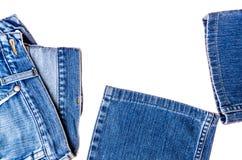 在白色背景隔绝的使用的蓝色牛仔裤 免版税图库摄影