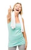 在白色背景隔绝的健康成熟妇女赞许标志 免版税库存图片