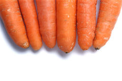 在白色背景隔绝的六棵丑恶的红萝卜 库存图片