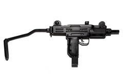 在白色背景隔绝的冲锋枪,气动力学的武器 库存图片