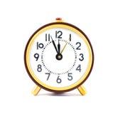 在白色背景隔绝的减速火箭的时钟 免版税图库摄影