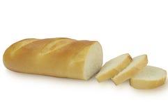 在白色背景隔绝的切的长的面包 免版税库存照片