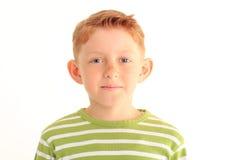 在白色背景隔绝的可爱的年轻男孩画象  库存照片
