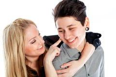在白色背景隔绝的同性恋人 库存图片
