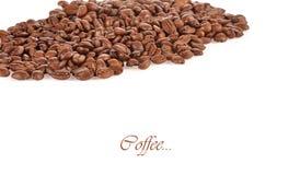 在白色背景隔绝的咖啡粒 库存照片