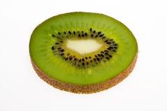 在白色背景隔绝的唯一切片猕猴桃新鲜的绿色果子 免版税库存图片