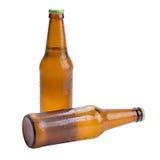 在白色背景隔绝的啤酒瓶褐色 免版税库存照片
