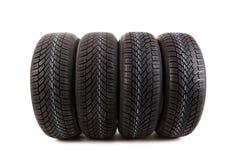 在白色背景隔绝的四个冬天轮胎 免版税图库摄影
