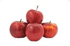 在白色背景隔绝的四个红色苹果金字塔  库存图片