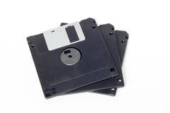 在白色背景隔绝的堆黑磁盘 免版税库存图片