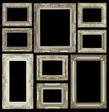 在白色背景隔绝的套金黄葡萄酒框架 库存照片