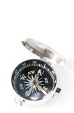 在白色背景隔绝的小口袋指南针 免版税库存照片