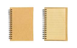 在白色背景隔绝的小棕色笔记本 库存照片
