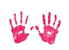 在白色背景隔绝的左右孩子红颜色handprint 免版税图库摄影