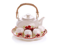 在白色背景隔绝的微型茶具 免版税库存照片