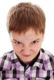 非常恼怒的十几岁的男孩 免版税库存照片