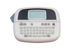 在白色背景隔绝的手扶的贴标签机 免版税库存图片