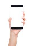 在白色背景隔绝的手智能手机 免版税库存照片