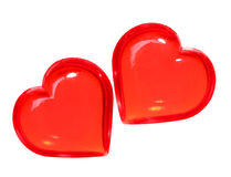 在白色背景隔绝的拖曳红色心脏。情人节 库存照片