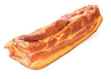 在白色背景隔绝的新近地抽烟的猪肉 库存照片