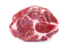 在白色背景隔绝的新鲜的粗暴猪肉脖子肉牛排 图库摄影