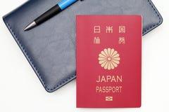 在白色背景隔绝的日本护照 库存图片
