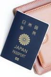 在白色背景隔绝的日本护照 库存照片