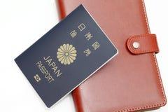 在白色背景隔绝的日本护照 免版税库存照片