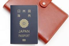 在白色背景隔绝的日本护照 免版税库存图片