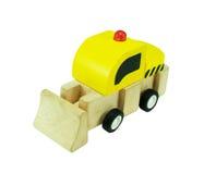 在白色背景隔绝的木推土机玩具 库存照片