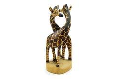 在白色背景隔绝的木知己长颈鹿雕象 免版税库存图片
