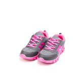在白色背景隔绝的桃红色体育鞋子 免版税库存照片