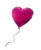 在白色背景隔绝的桃红色心脏气球 库存照片