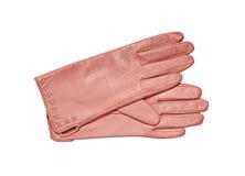在白色隔绝的女性桃红色手套 库存照片